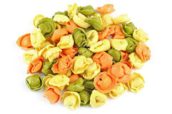 Raw colored tortellini on white background Stock Images