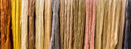 Raw Colorful silk on the clothes line stock photography