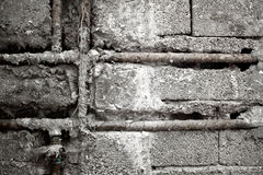 Raw concrete brick wall and water pipe background Stock Photos