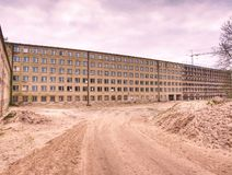 Concrete Building with broken windows at Prora stock photography