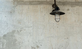 Raw concrete texture with old lamp. Stock Images