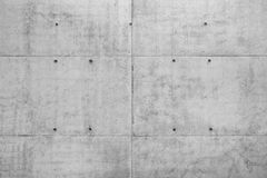 Raw Concrete Wall. Raw gray concrete wall of a new building as full frame background royalty free stock photos