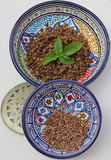 Raw & cooked lentils. Raw and cooked red lentils presented in tunisian jaws Stock Photo