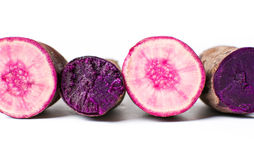 Raw and cooked purple potatoes isolated Stock Photography