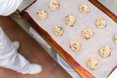 Raw cookie dough on a baking tray with parchment paper Stock Images