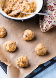 Raw cookie dough on a baking tray with parchment paper Royalty Free Stock Photo