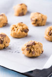 Raw cookie dough on a baking tray with parchment paper Royalty Free Stock Images