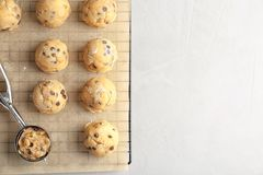 Raw cookie dough with chocolate chips and scoop. On parchment paper, top view Royalty Free Stock Photography