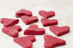 Raw cookie dough heart of beet on a white table Stock Photography