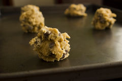 Raw Cookie Dough. Scoops of raw cookie dough on a baking pan Royalty Free Stock Photo