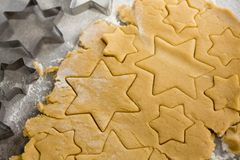 Raw cookie dough with star shape and cutter Royalty Free Stock Image
