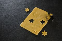 Raw cookie dough with star shaped cookie cutter Stock Image