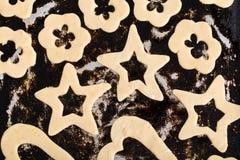 Raw cookies on black baking pan. Royalty Free Stock Photos