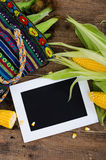 Raw corn on dark wood table with white frame Royalty Free Stock Image