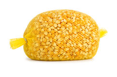 Raw corn grains package for popcorn making Royalty Free Stock Photo
