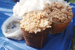 Raw cotton in the woven basket Stock Photos