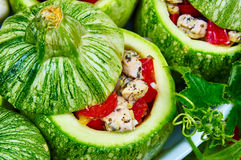 Raw courgettes with stuffing. Raw courgettes stuffed with meat and vegetables Royalty Free Stock Images