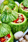Raw courgettes with stuffing. Raw courgettes stuffed with meat and vegetables Stock Photography