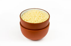 Raw couscous in bowl Stock Photography