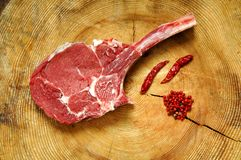 Raw Cowboy Ribeye. On the wood Stock Images