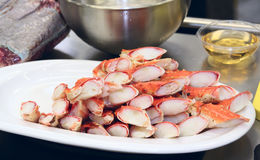 Raw crab legs, oil and meat on commercial citchen Royalty Free Stock Image