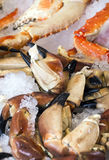 Raw crab legs. In a vertical image at the Bengen market Stock Photos