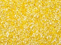 Raw crushed corn groats Royalty Free Stock Image