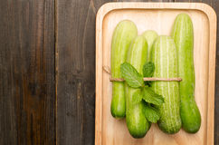 Raw cucumber. On wooden plate Stock Photography