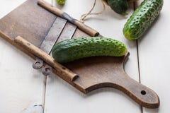 Raw cucumbers on cutting board. Selective focus Stock Photo