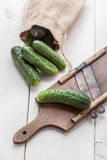 Raw cucumbers on cutting board. Selective focus Royalty Free Stock Images