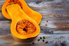 Raw cut butternut pumpkin on kitchen table Royalty Free Stock Images
