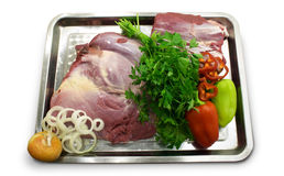 Raw cut of meat with vegetables Stock Image