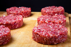 Raw Cutlet Of Minced Meat On A Wooden Cutting Board. Shallow Depth Of Field. Toned Stock Photography