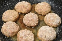 Raw cutlets of the beef and pork raw minced meat. Raw homemade chops Stock Photos