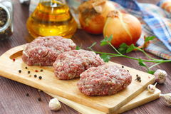 Raw cutlets on a chopping board and ingredients. Ready for cook Royalty Free Stock Image