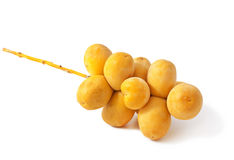 Raw dates. A bunch of yellow raw dates on white background Stock Photography