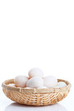 Raw dirty duck eggs in the bamboo bowl basket. On white background Stock Image