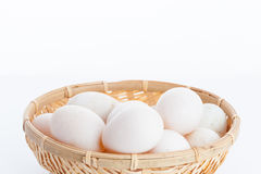 Raw dirty duck eggs in the bamboo bowl basket Stock Photo