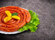 Raw domestic stuffed sausage in plate with clipping path.  Stock Photos