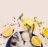 Raw dorado fish with oil and lemon on white wooden background, top view. Close up Royalty Free Stock Photos