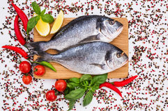 Raw dorado fish on wooden cutting board. Top view. Copy space Stock Photo