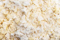 Raw dough background, bright crumbles for bakery goods stock photography