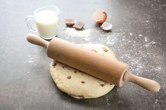 Raw dough with chocolate chips. On table Stock Images