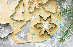 Raw dough for Christmas cookies and cookie cutters shaped glove, Royalty Free Stock Photo