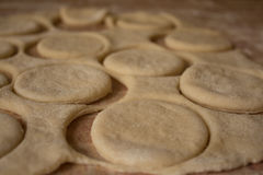 Raw dough cookies with flour on table Stock Image