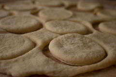 Raw dough cookies with flour on table Royalty Free Stock Images
