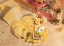Raw dough and Italian homemade tortellini and ravioli,open and closed,filled with ricotta cheese ,mushrooms and aromatic herbs. Royalty Free Stock Photos