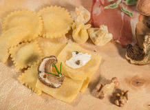 Raw dough and Italian homemade tortellini and ravioli,open and closed,filled with ricotta cheese,mushrooms and aromatic herbs. Stock Image