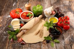 Raw dough pizza. And ingredient Royalty Free Stock Image