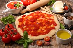 Raw dough pizza. And ingredient Royalty Free Stock Photography